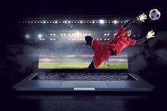 Piłka nożna bramkarz w akci Mieszani środki Obrazy Royalty Free