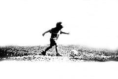 piłka nożna gracza dziecka Obrazy Royalty Free