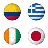 Piłka nożna pucharu świata 2014 C grupowe flaga na soccerballs Zdjęcie Stock