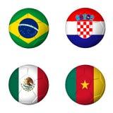 Piłka nożna pucharu świata 2014 grupa A zaznacza na soccerballs Fotografia Stock