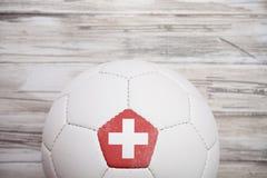 Piłka nożna: Szwajcaria piłki nożnej piłki tło Dla zawody międzynarodowi Com Fotografia Stock