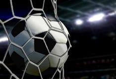 Piłka w cel sieci z stadiów światłami reflektorów Obrazy Stock