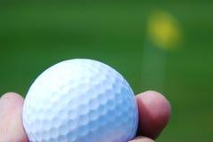 piłki golfa ręki mienie zdjęcie royalty free