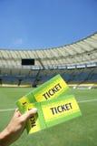 Piłki nożnej fan Trzyma Dwa Brazylia bileta przy stadium Zdjęcie Royalty Free