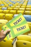 Piłki nożnej fan Trzyma Dwa Brazylia bileta przy stadium Obraz Royalty Free