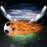 Piłki nożnej kula ognia przy stadium Zdjęcia Royalty Free