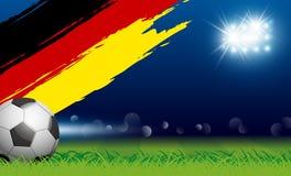 Piłki nożnej piłka na trawie i paintbrush Germany zaznaczamy w stadium Fotografia Royalty Free