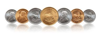 Pi?ces de monnaie sud-africaines de lingot d'or d'argent et d'once de Krugerrand photos stock