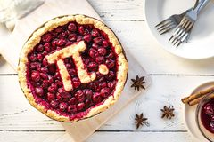 Pi Day Cherry Pie. Homemade Traditional Cherry Pie with Pi sign for March 14th holiday royalty free stock images