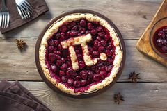 Pi Day Cherry Pie. Homemade Traditional Cherry Pie with Pi sign for March 14th holiday royalty free stock image