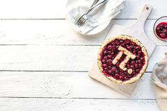 Pi Day Cherry Pie. Homemade Traditional Cherry Pie with Pi sign for March 14th holiday, on white wooden background, top view, copy space stock photography