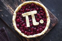 Pi Day Cherry Pie. Making homemade traditional Cherry Pie with Pi sign for March 14th holiday, close up royalty free stock images