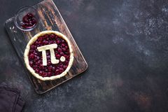 Pi Day Cherry Pie. Making homemade traditional Cherry Pie with Pi sign for March 14th holiday, on rustic background, top view, copy space royalty free stock photos