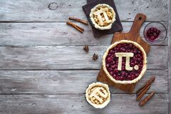 Pi Day Pies. Pi Day Cherry and Apple Pies - making homemade traditional various Pies with Pi sign for March 14th holiday, on rustic wooden background, top view royalty free stock photography