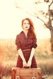 Piękna dziewczyna w szkockiej kraty sukni Fotografia Stock