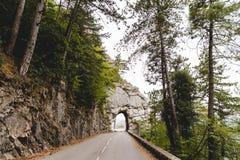 piękna halna droga z tunelem w skale, Peille, Francja fotografia royalty free