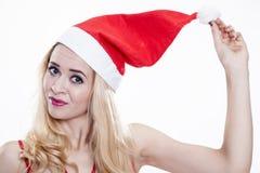 Piękna i seksowna kobieta jest ubranym Santa klauzula kostium Zdjęcia Stock