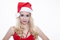 Piękna i seksowna kobieta jest ubranym Santa klauzula kostium Obrazy Royalty Free