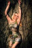 Piękna kobieta i drzewo Fotografia Royalty Free