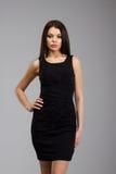 Piękna kobieta w czarnej sukni Zdjęcie Stock