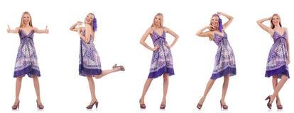 Pi?kna kobieta w purpury sukni odizolowywaj?cej na bielu zdjęcie stock