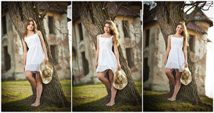 Piękna portret dziewczyna z kapeluszem blisko drzewa w ogródzie. czarodziejski princess w biel sukni w ogródzie. portret wiejska d Obraz Royalty Free