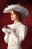 Piękne rudzielec kobiety z cukierkiem. Obraz Stock