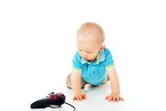 Piękni kraule dziecko joystick i Fotografia Stock