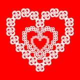 Piękni kwiaty w formie serca na czerwieni Fotografia Stock