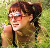 piękny dziewczyny trawy lying on the beach Obraz Royalty Free