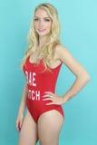 Piękny ratownik jest ubranym czerwonego swimsuit Obrazy Royalty Free
