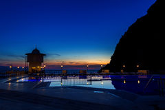 Piękny zmierzch z odbiciem w basenie Obrazy Royalty Free