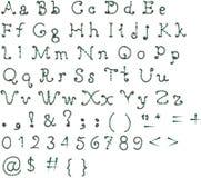 Pia batismal original, alfabeto em um fundo branco Fotos de Stock