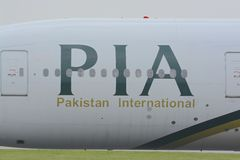 PIA jet aircraft. Close up view of a PIA ( Pakistan International Airlines ) jet aircraft logo / brand, at Manchester airport Stock Photos