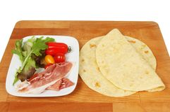 Piada and ingredients. Ona wooden chopping board Royalty Free Stock Photography
