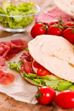 Piadina with ham and lettuce. Royalty Free Stock Photography