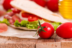 Piadina with ham and lettuce. Stock Photography