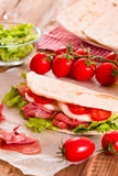 Piadina with ham and lettuce. Royalty Free Stock Photo