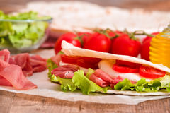 Piadina with ham and lettuce. Royalty Free Stock Image