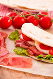 Piadina with ham and lettuce. Stock Photos