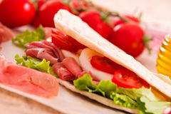 Piadina with ham and lettuce. Royalty Free Stock Images