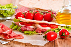 Piadina with ham and lettuce. Stock Images