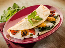 Piadina with spinach Royalty Free Stock Image