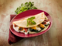 Piadina with spinach Stock Images