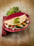 Piadina with spinach Stock Image