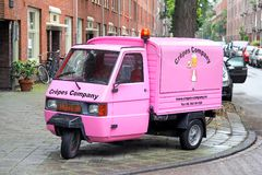 Piaggio Ape. AMSTERDAM, NETHERLANDS - AUGUST 10, 2014: Pink three-wheeled light commercial vehicle Piaggio Ape at the city street royalty free stock photo