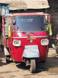 Piaggio Ape at the indian rural village. The Piaggio Ape is a three-wheeled light commercial vehicle first produced in 1948 by Piaggio.  In 1947 the inventor Stock Image
