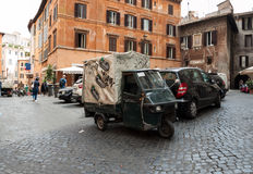 Piaggio Ape50 in Rome. Piaggio Ape is a three-wheeled light commercial vehicle first produced in 1948 by Piaggio Stock Images