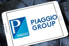Piaggio motor vehicle manufacturer logo. Logo of Piaggio company on samsung tablet on wooden background. Piaggio is an Italian motor vehicle manufacturer, which Stock Photography