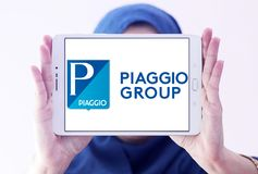 Piaggio motor vehicle manufacturer logo. Logo of Piaggio company on samsung tablet holded by arab muslim woman. Piaggio is an Italian motor vehicle manufacturer Stock Image